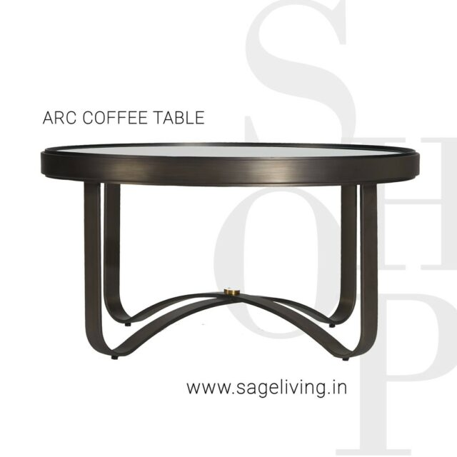 """A strategic interplay of curves that makes this minimal design beautiful and transcendental.  THE ARC COFFEE TABLE.  DIMENSIONS: D 36"""" X H 19""""  FINISH: GUNMETAL SHOP NOW: www.sageliving.in #SageLiving #WeLoveSage   . . . . . . . . . .  #homedecorating #homedecorideas #decoratingideas #interiorinspo #glamdecor #homeinspiration #decoratingideas #decor #styleathome #interiorsofinstagram #houseandhome #transitionaldecor #interiorstyling #interiordesign #interiorandhome #Interiorinspiration #indianhomes #interiorstyle"""